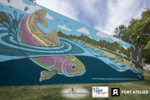 Close up of fish in the mural and the quote by John F. Kennedy.