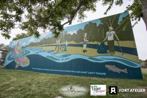 Mural with fish, river, and people picking up trash and helping the environment